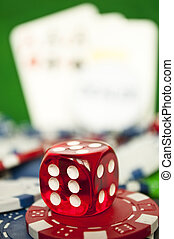 Poker red dice on stack of casino chips - macro shot