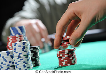 poker player takes the chips, the opponent on the background