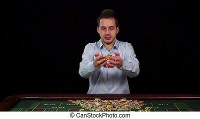 Poker winner, chips in the air, black, slow motion