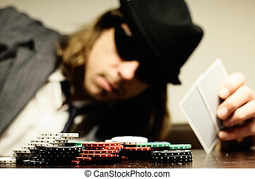 Pokerface - Man with hat and glasses playing underground...