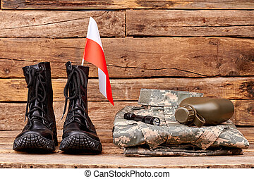 Poland army soldier uniform with flag, bottle and torch.