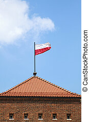 Poland flag on a blue sky background