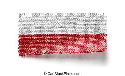 Poland flag on a piece of cloth on a white background