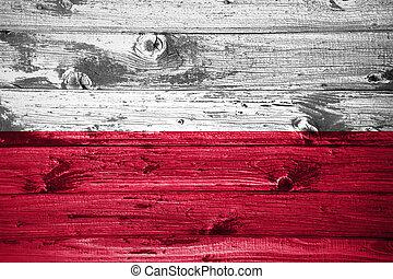 Poland flag on wooden planks background