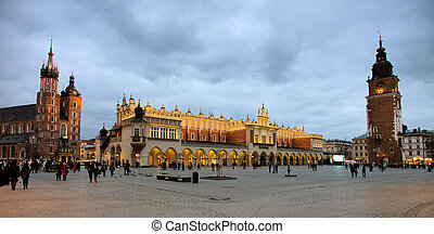 the city of krakow in poland. marketplace with (left to right) st. mary's cathedral, tuchlauben, town hall tower