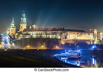 Krakow old city at night. Wawel Castle and Wistula. Krakow Poland. Beautiful sunset