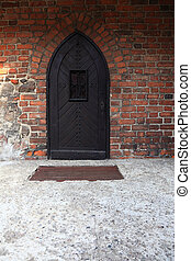 Old Wooden Door on Grunge Brick Wall
