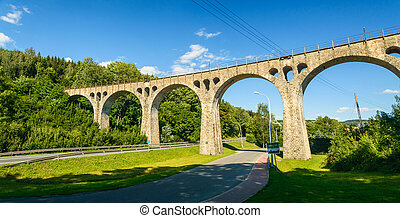 Old railway viaduct in the mountains above the road, Lewin Klodzki.