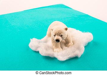 Polar bear on ice on water