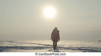 Polar Explorer Comes Back From Sunset - Arctic Blizzard....