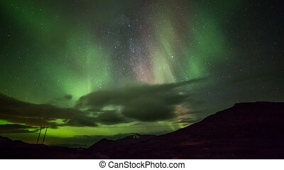 polar lights (aurora borealis) in the mountains in Norway in...