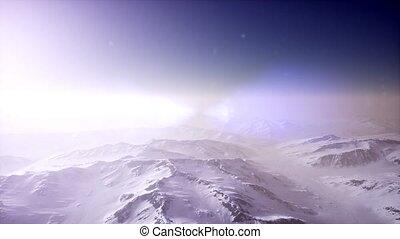 Polar Snow Rocky Mountains Ridges In a cold polar region -...