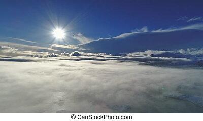 Polar sun above surface fog. Antarctic aerial shot -...