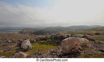 polar tundra and stone heaps human ancient - hills near the...