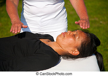 Polarity massage; a technique of gently rocking, holding and massaging to stimulate relaxation, restore energy flow and encourage revitalization
