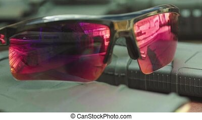 Polarized safety glasses for shooting. Close-up. Stock video...