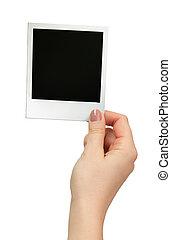 polaroid, foto, in, hand, vrijstaand