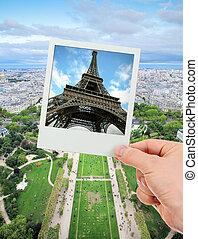 Polaroid frame of Eiffel tower over The Champ de Mars of...