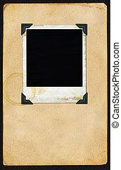 Polaroid on Page - Aged polaroid with photo corners on aged...