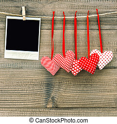 Polaroid photo frame and textile red hearts. Valentines Day...