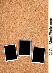 Polaroid photo frames on cork texture background with...