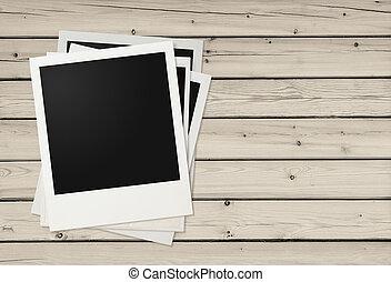 Polaroid photo frames on wooden background - Polaroid photo...