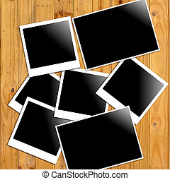 polaroid photo frames on wooden wall background