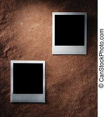 polaroid style photo frames on vintage paper