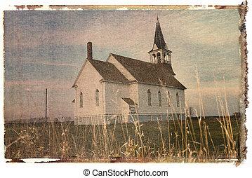 Polaroid transfer of small rural church in field.