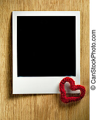 Polaroid vintage empty photo card decorated with a tiny heart on
