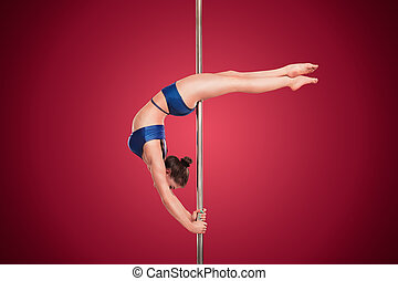 Pole dance - Attractive pole dance woman posing in...