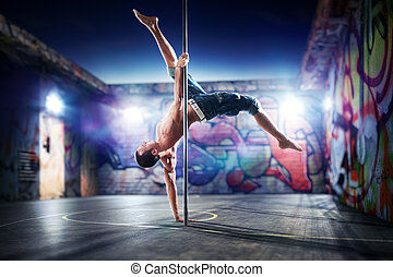 Pole dance man - Young strong pole dance man on urban...