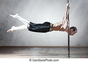 Pole dance man - Young strong pole dance man.