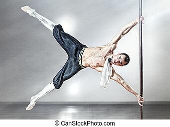 Pole dance man - Young strong pole dance man.