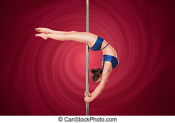 Pole dance - Sexy pole dance woman in studio. Young pole...