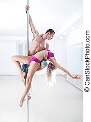 Pole dance team - Man and woman pole dance team.