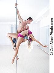 Pole dance team - Man and woman pole dance team.