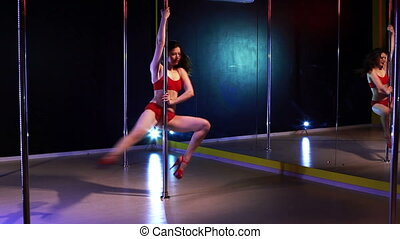 Pole dance woman tricks.