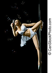 Pole Dance Woman - young sexy dance woman on pole, blow...