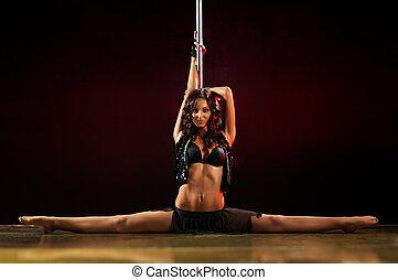 Pole dance woman - Young sexy pole dance woman.