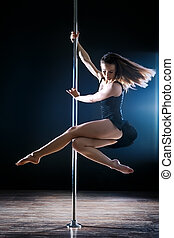Pole Dance Woman - young sexy dance woman turning on pole
