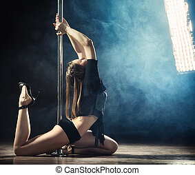 Pole Dance Woman - young sexy pole dance woman, dark...