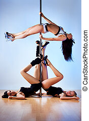 Pole dance women - Three young slim pole dance women.