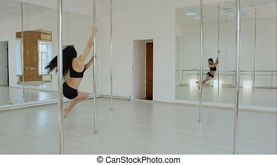 Pole dancer posing near pylon. Professional shot in 4K ...
