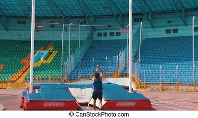 Pole vault - a bearded athletic man jumping over the bar....