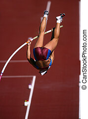 A female pole vaulter in action