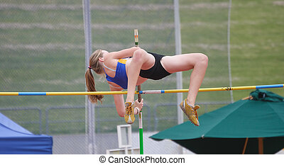 Pole Vault - Female pole vaulter clearing the bar
