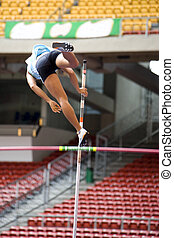 Pole Vault - Image of a female pole vaulter in action.