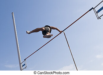 Male athlete at pole vault action competition.
