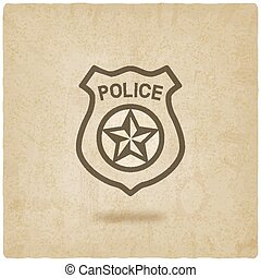 police badge symbol old background